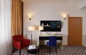Телевизор и/или развлекательный центр в Отель Ногай