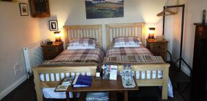 A bed or beds in a room at Lighthouse Cottage (Shared Facilities)