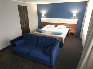 Кровать или кровати в номере Гостиница Маяк