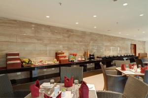 A restaurant or other place to eat at Seashell Suites and Villas