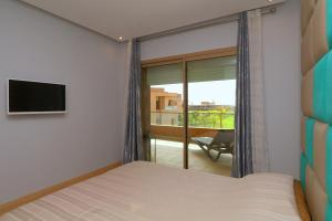 A bed or beds in a room at Appartement XL Prestigia Topaze