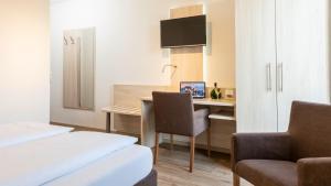 TV/Unterhaltungsangebot in der Unterkunft Hotel Am Wiesenweg l 24h check-in