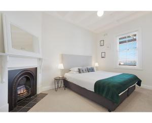 A bed or beds in a room at Heritage home in the heart of the city