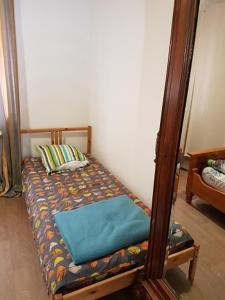A bed or beds in a room at Le Bioumonais