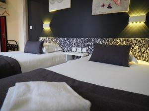 Un ou plusieurs lits dans un hébergement de l'établissement Hôtel de Biarritz