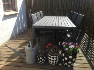 En terrasse eller udendørsområde på Løkken Farm Holiday