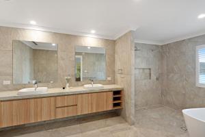 A bathroom at La Bella Apartments