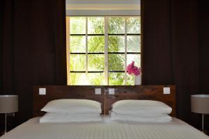 Cama ou camas em um quarto em Jan Kok Lodges