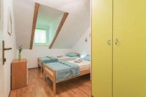 A bed or beds in a room at Ankora Apartment