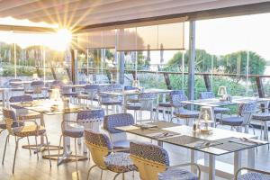 A restaurant or other place to eat at Martinhal Sagres Beach Family Resort Hotel