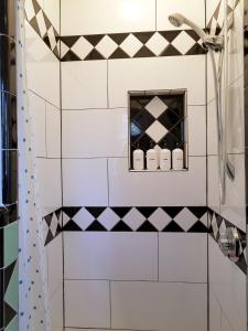 A bathroom at Whimsical Charm at Historic M-Streets Suite
