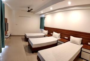 A bed or beds in a room at Pride Home