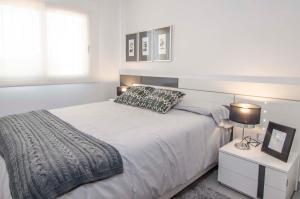 Een bed of bedden in een kamer bij Mar de Pulpí Costa de Almeria Mar Holidays