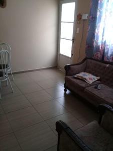 A bed or beds in a room at Seu Apartamento em Itaúna