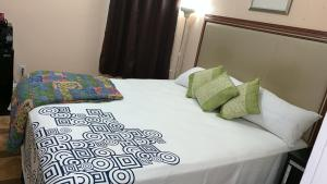 A bed or beds in a room at Oak Hotel