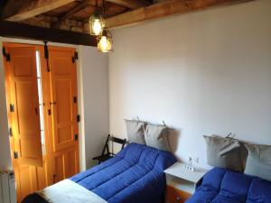 A bed or beds in a room at Casa de los Hidalgos