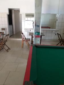 A kitchen or kitchenette at Pousada Universitário