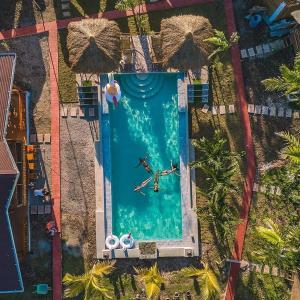 A view of the pool at Glamping Alona or nearby