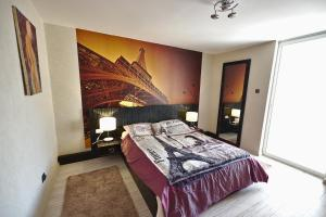 A bed or beds in a room at 4 ApartsHotel Galati Faleza