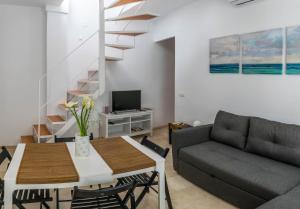 Zona de estar de MALAMA Apartamentos Turísticos