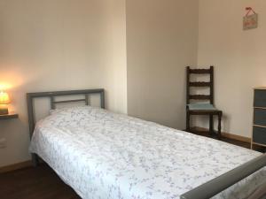 Un ou plusieurs lits dans un hébergement de l'établissement Le Gite du Lac de Bairon