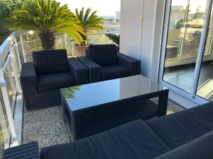 A seating area at Gorgeous one-bedroom apartment with terrace and sea view -StayInAntibes- Bijou Plage