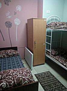 Кровать или кровати в номере Hop Home Hostel