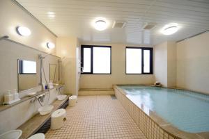 A bathroom at Amami Sunplaza Hotel