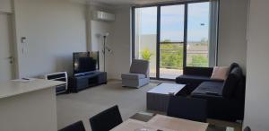 A seating area at Modern furnished apartment close to everything!