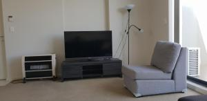 A television and/or entertainment center at Modern furnished apartment close to everything!