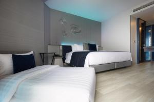 A bed or beds in a room at Grande Centre Point Pattaya