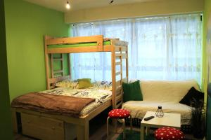 A bunk bed or bunk beds in a room at Fancy Hostel