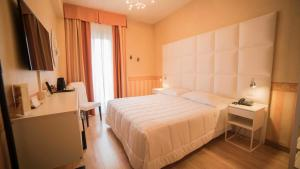 Letto o letti in una camera di Hotel Jane