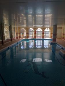 The swimming pool at or near Riviera Hotel
