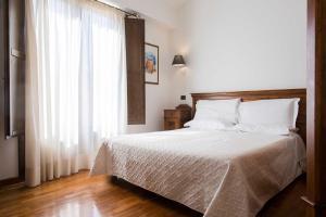 Letto o letti in una camera di Hotel La Piazzetta