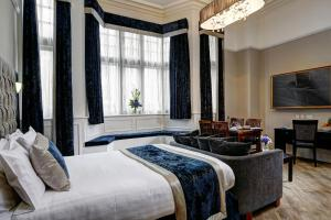 A bed or beds in a room at The Richmond Hotel; BW Signature Collection