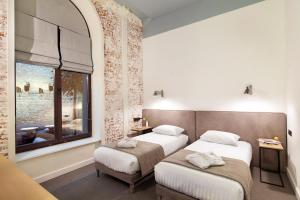 A bed or beds in a room at FERENC Hotel & Restaurant