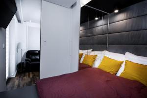Łóżko lub łóżka w pokoju w obiekcie Apartament Rynek22