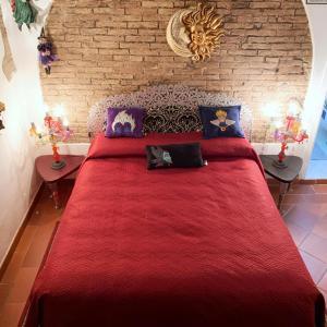 Letto o letti in una camera di L'Ora delle Streghe Charme and Design b&b