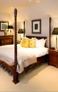 A bed or beds in a room at The Lion Inn