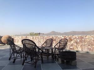 A balcony or terrace at Jai Villa Homestay