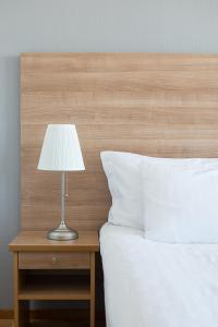A bed or beds in a room at Quality Hotel Bodensia