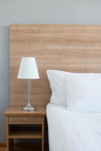 Säng eller sängar i ett rum på Quality Hotel Bodensia