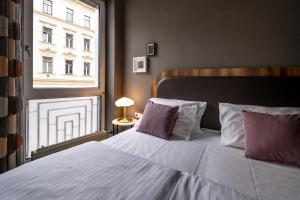 A bed or beds in a room at Koncept Hotel Liebelei - contactless check-in
