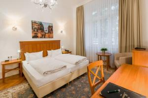 Ein Bett oder Betten in einem Zimmer der Unterkunft Hotel Brandies an der Messe