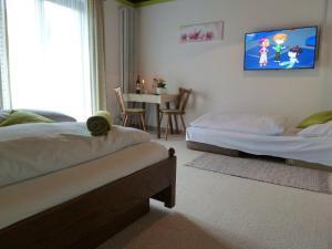 Ein Bett oder Betten in einem Zimmer der Unterkunft Schöne Aussicht