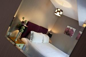 A bed or beds in a room at The Sherwood