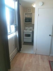 A kitchen or kitchenette at Alisa Guest Suites
