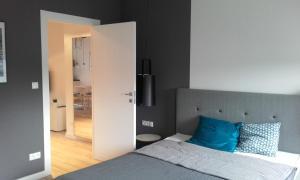 Łóżko lub łóżka w pokoju w obiekcie Silver Apartments