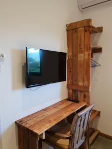 A television and/or entertainment center at Villa Alizee